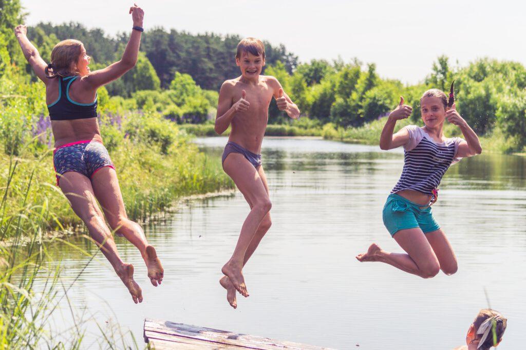 2 men running on water during daytime